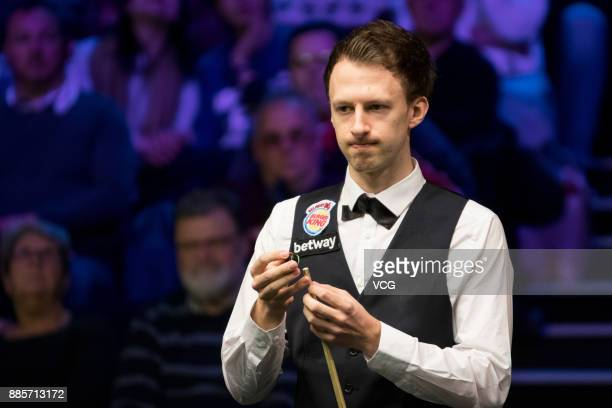 Judd Trump of England chalks the cue during his third round match against Graeme Dott of Scotland on day 8 of 2017 Betway UK Championship at Barbican...