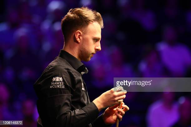 Judd Trump of England chalks the cue during the 3rd round match against Igor Figueiredo of Brazil on day four of the 2020 ManBetX Welsh Open at the...