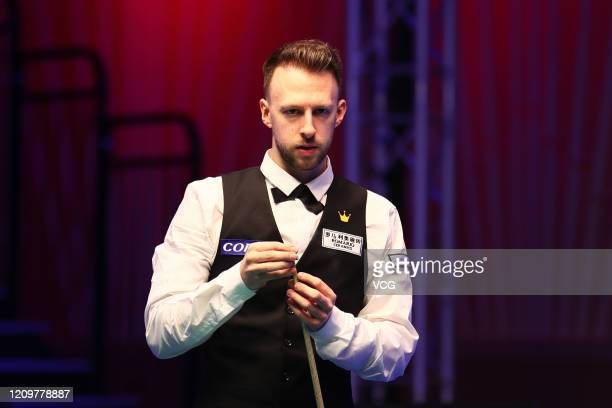 Judd Trump of England chalks the cue during the final match against Yan Bingtao of China on day seven of 2020 Coral Players Championship at Southport...