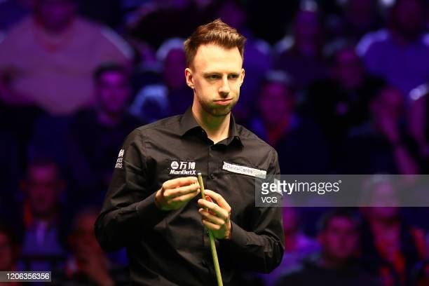 Judd Trump of England chalks the cue during the quarterfinal match against Shaun Murphy of England on day five of the 2020 ManBetX Welsh Open at the...