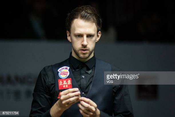 Judd Trump of England chalks the cue during the semifinal match against Jack Lisowski of England on day five of 2017 Shanghai Masters at Shanghai...