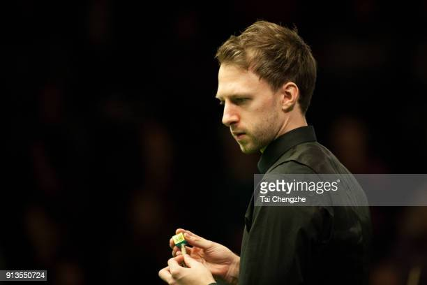 Judd Trump of England chalks the cue in his quarterfinal match against Ding Junhui of China on day three of 2018 D88 German Masters at Tempodrom on...
