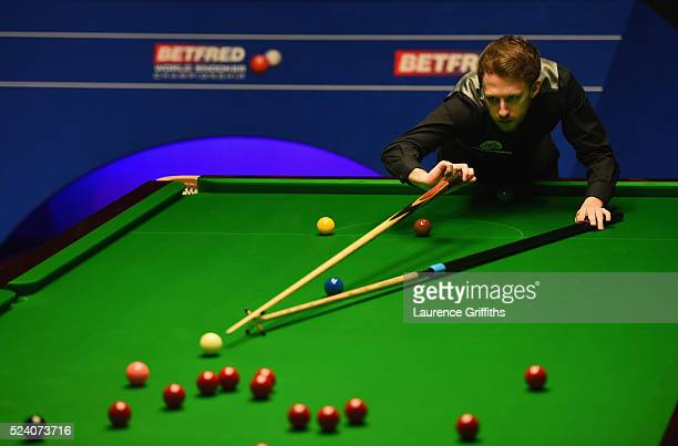 Judd Trump of England in action during his second round match against Ding Junhui of China on day ten of the World Snooker Championship at Crucible...