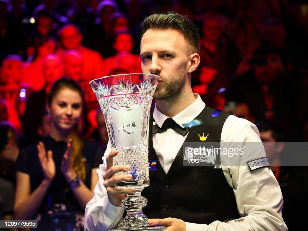 Judd Trump of England kisses his trophy after winning the final match against Yan Bingtao of China on day seven of 2020 Coral Players Championship at...