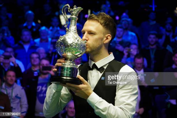 Judd Trump of England kisses the trophy after winning the final match against Ali Carter of England on day 7 of the 2019 Coral World Grand Prix at...