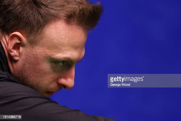 Judd Trump of England looks on as he plays a shot during the Betfred World Snooker Championship Round Two match between David Gilbert of England and...