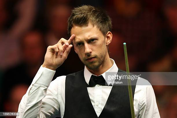 Judd Trump of England looks on during his first round match against Barry Hawkins of England at Alexandra Palace on January 15 2013 in London England