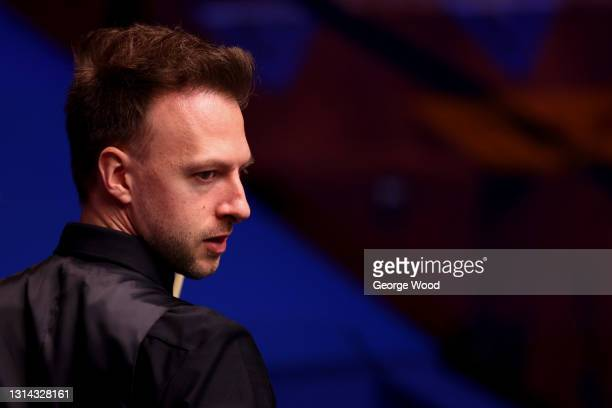 Judd Trump of England looks on during the Betfred World Snooker Championship Round Two match between David Gilbert of England and Judd Trump of...