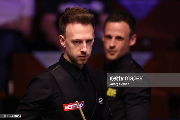 Judd Trump of England looks on in front of David Gilbert of England during the Betfred World Snooker Championship Round Two match between David...