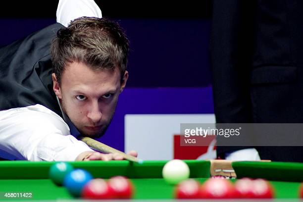 Judd Trump of England plays a shot against Jamie Burnett of Scotland on day three of the World Snooker International Championship 2014 at the Sichuan...