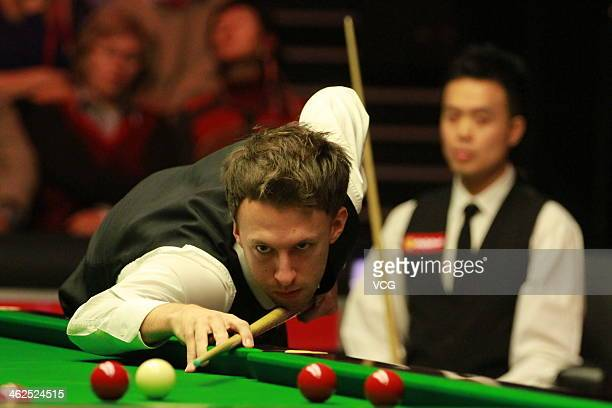 Judd Trump of England plays a shot against Marco Fu of Hong Kong on day two of the 2014 Dafabet Masters at the Alexandra Palace on January 13 2014 in...
