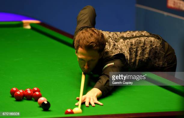Judd Trump of England plays a shot against Rory McLeod during their first round match of the World Snooker Championship at Crucible Theatre on April...