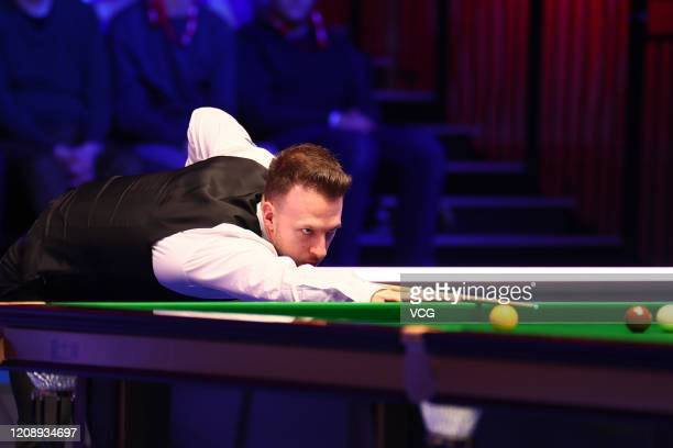 Judd Trump of England plays a shot during a quarterfinal match against John Higgins of Scotland on day three of 2020 Coral Players Championship at...