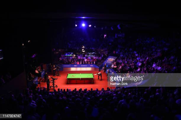 Judd Trump of England plays a shot during day 17 of the 2019 Betfred World Snooker Championship final between John Higgins and Judd Trump at Crucible...