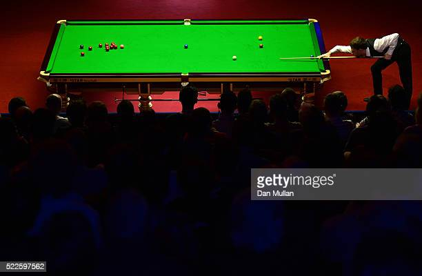 Judd Trump of England plays a shot during his first round match against Liang Wenbo of China on day 5 of the World Snooker Championship at The...