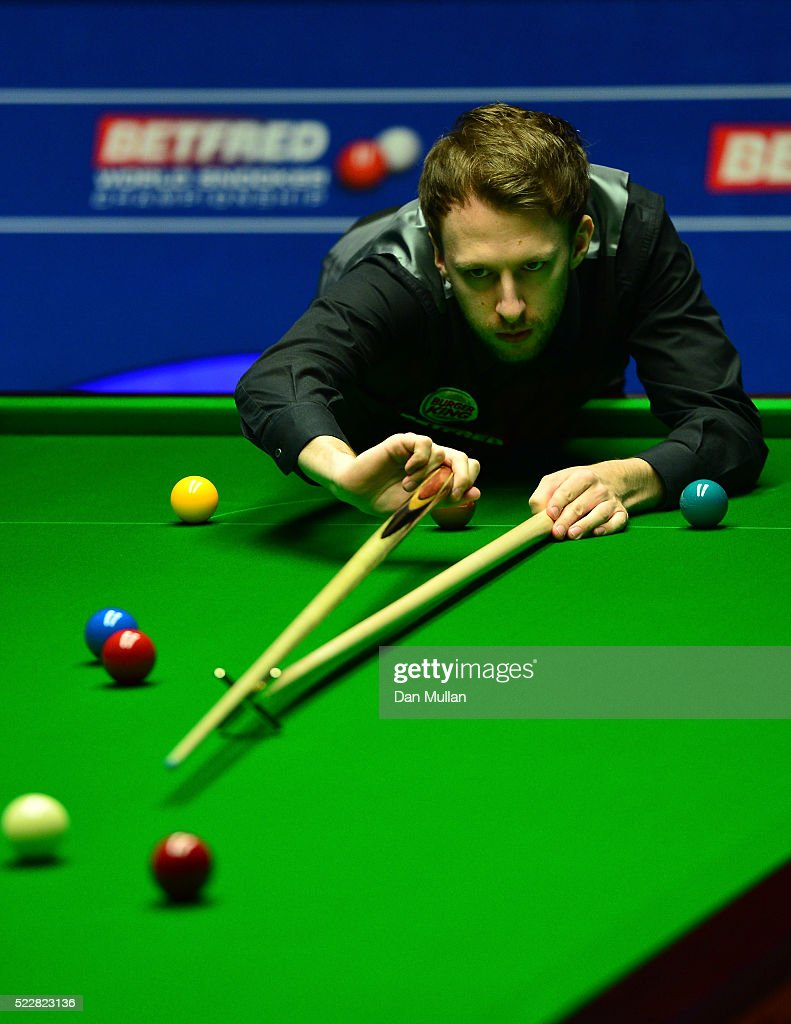 Judd Trump of England plays a shot during his first round match against Liang Wenbo of China on day six of the World Snooker Championship at The Crucible Theatre on April 21, 2016 in Sheffield, England.