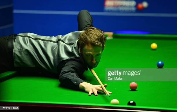 Judd Trump of England plays a shot during his first round match against Liang Wenbo of China on day six of the World Snooker Championship at The...