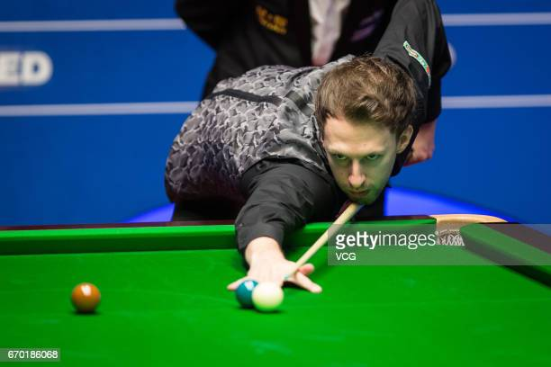Judd Trump of England plays a shot during his first round match against Rory McLeod of England on day five of Betfred World Championship 2017 at...