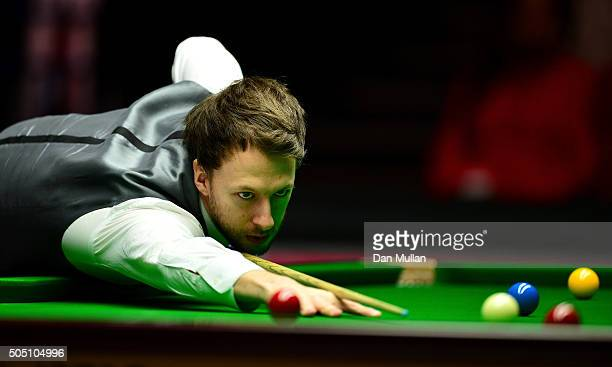 Judd Trump of England plays a shot during his quarter final match against Neil Robertson of Australia during Day Six of The Dafabet Masters at...