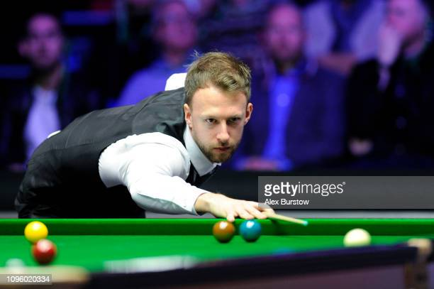 Judd Trump of England plays a shot during his quarterfinal match against Mark Selby of England on day six of the 2019 Dafabet Masters at Alexandra...