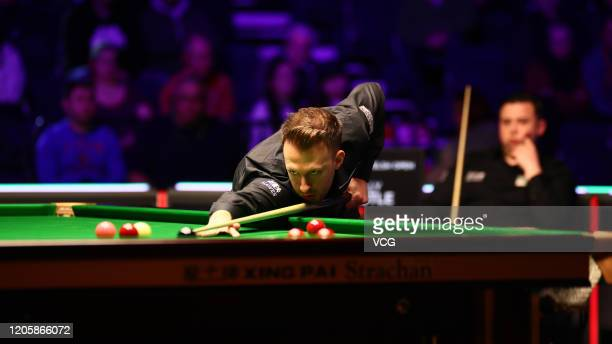 Judd Trump of England plays a shot during the 2nd round match against Billy Joe Castle of England on day three of the 2020 ManBetX Welsh Open at the...