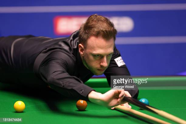 Judd Trump of England plays a shot during the Betfred World Snooker Championship Round One match between Liam Highfield of England and Judd Trump of...