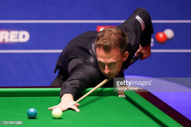 Judd Trump of England plays a shot during the Betfred World Snooker Championship Round Two match between David Gilbert of England and Judd Trump of...