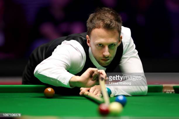 Judd Trump of England plays a shot during The Dafabet Masters Final between Judd Trump of England and Ronnie O'Sullivan of England at Alexandra...