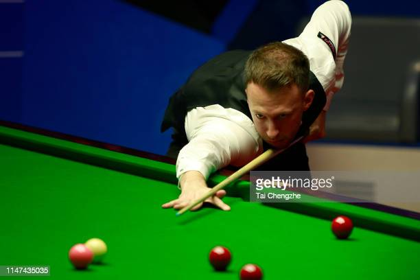 Judd Trump of England plays a shot during the final match against John Higgins of Scotland on day 17 of the 2019 Betfred World Snooker Championship...