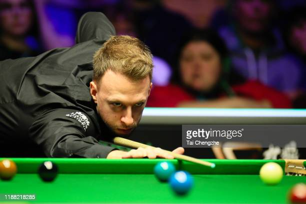 Judd Trump of England plays a shot during the final match against Ronnie O'Sullivan of England on day seven of 2019 Northern Ireland Open at...