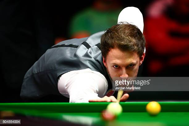 Judd Trump of England plays a shot in his first round match against Stephen Maguire of Scotland during Day Two of the Dafabet Masters at Alexandra...