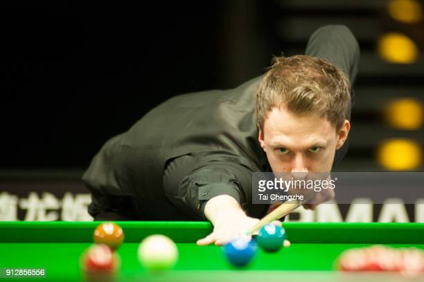 Judd Trump of England plays a shot in his first round match against Ben Woollaston of England on day one of 2018 D88 German Masters at Tempodrom on...