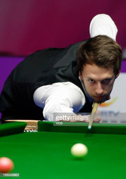 Judd Trump of England plays a shot in his match against Fergal O'Brien of Ireland on day three of the 2012 World Snooker International Championship...