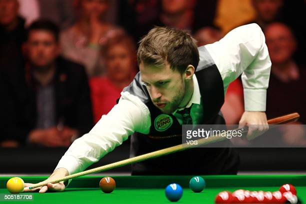 Judd Trump of England plays a shot in his quarterfinal match against Neil Robertson of Australia during day six of The Dafabet Masters 2016 at...