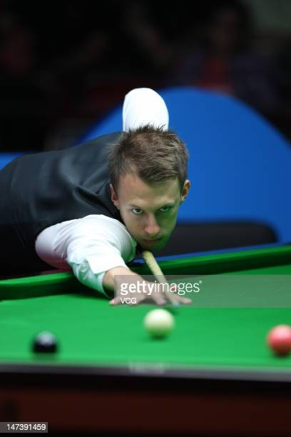 Judd Trump of England plays a shot in the match against Robert Milkins of England on day three of the 2012 World Snooker Wuxi Classic at Wuxi Sports...