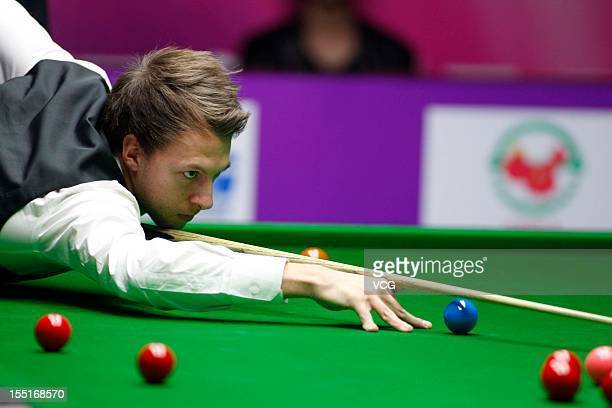 Judd Trump of England plays a shot in the quarter final match against Mark Allen of Northern Ireland on day five of the 2012 World Snooker...