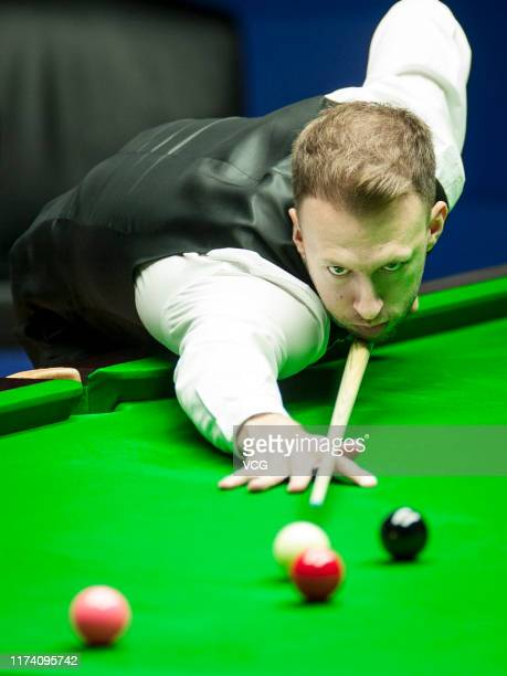 Judd Trump of England plays a shot in the quarterfinal match against Mark Allen of Northern Ireland on day 4 of World Snooker Shanghai Masters 2019...