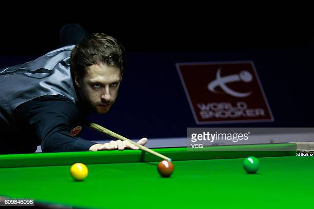 Judd Trump of England plays a shot in the second round match against Michael White of Wales on day four of the Shanghai Masters 2016 at Shanghai...