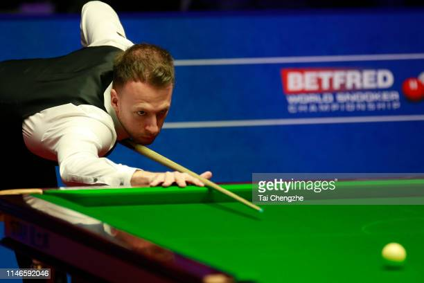 Judd Trump of England plays a shot in the semifinal match against Gary Wilson of England on day thirteen of the 2019 Betfred World Snooker...