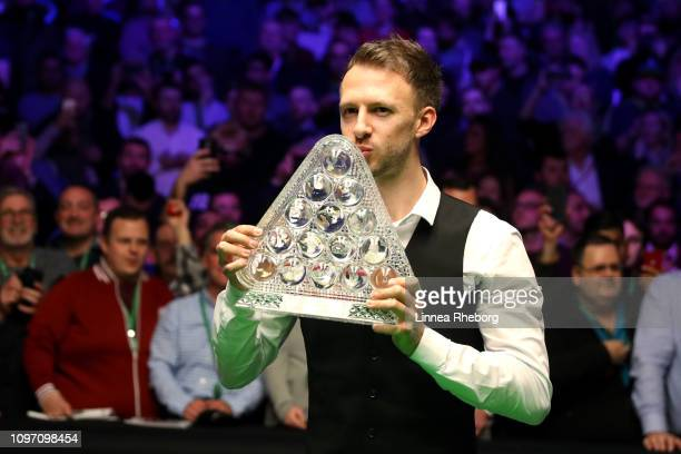 Judd Trump of England pose with the trophy following his win in The Dafabet Masters Final over Ronnie O'Sullivan of England at Alexandra Palace on...