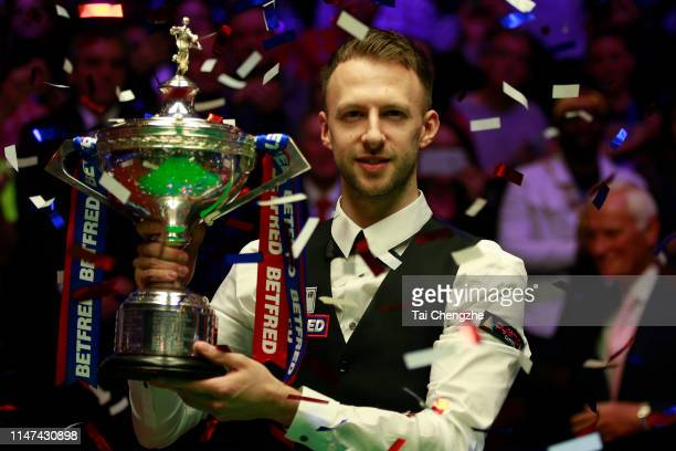 Judd Trump of England poses with his trophy after winning the final match against John Higgins of Scotland on day 17 of the 2019 Betfred World...