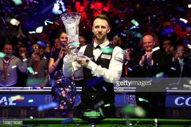 Judd Trump of England poses with his trophy after winning the final match against Yan Bingtao of China on day seven of 2020 Coral Players...