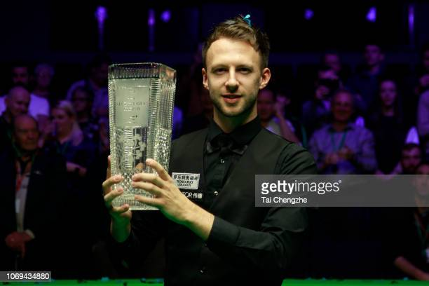 Judd Trump of England poses with the trophy after winning the final match against Ronnie O'Sullivan of England on day seven of 2018 BetVictor...