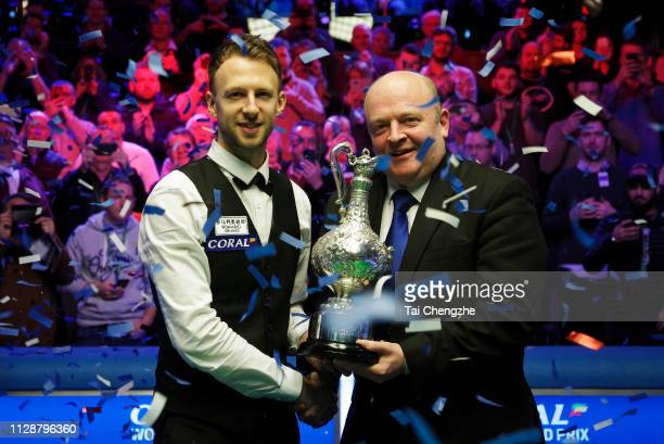 Judd Trump of England poses with the trophy after winning the final match against Ali Carter of England on day 7 of the 2019 Coral World Grand Prix...