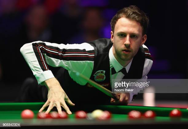 Judd Trump of England prepares to play a shot during his match against Liang Wenbo of China on day two of The Dafabet Masters at Alexandra Palace on...