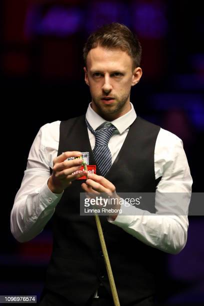 Judd Trump of England prepares to play a shot during The Dafabet Masters Final between Judd Trump of England and Ronnie O'Sullivan of England at...
