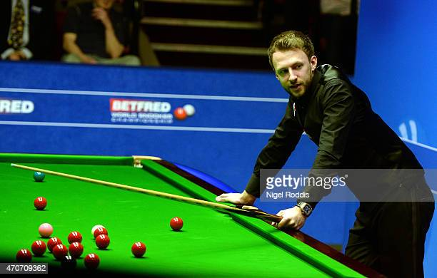 Judd Trump of England prepares to take a shot against Stuart Carrington of England during day five of the 2015 Betfred World Snooker Championship at...