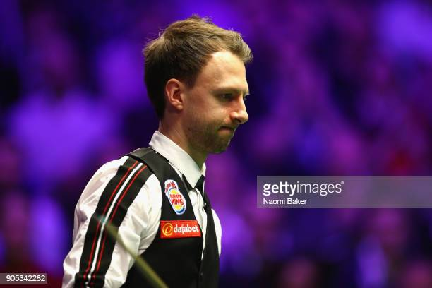 Judd Trump of England reacts after playing a shot during his match against Liang Wenbo of China on day two of The Dafabet Masters at Alexandra Palace...