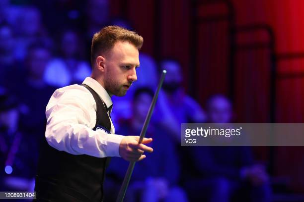 Judd Trump of England reacts during a quarter-final match against John Higgins of Scotland on day three of 2020 Coral Players Championship at...