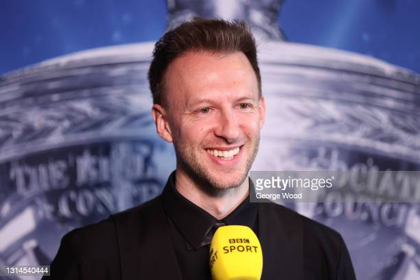 Judd Trump of England reacts during a TV interview following victory in the Betfred World Snooker Championship Round Two match between David Gilbert...